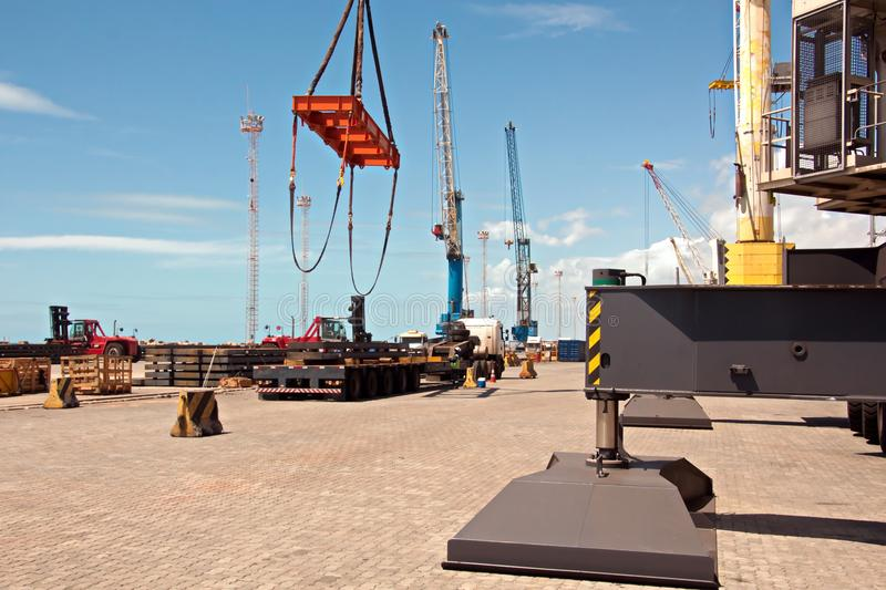 Transshipment terminal for loading steel products to sea vessels using shore cranes and special equipment in Port Pecem, Brazil,. Transshipment terminal for stock photography