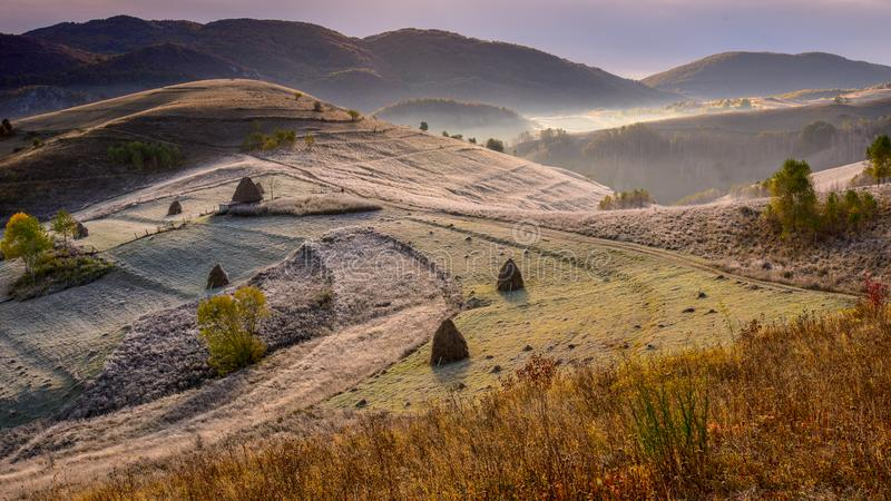 Transylvania landscape in autumn time with frost in the morning Romania. Transylvania landscape in autumn time with frost in the morning , old shepherd house in stock image