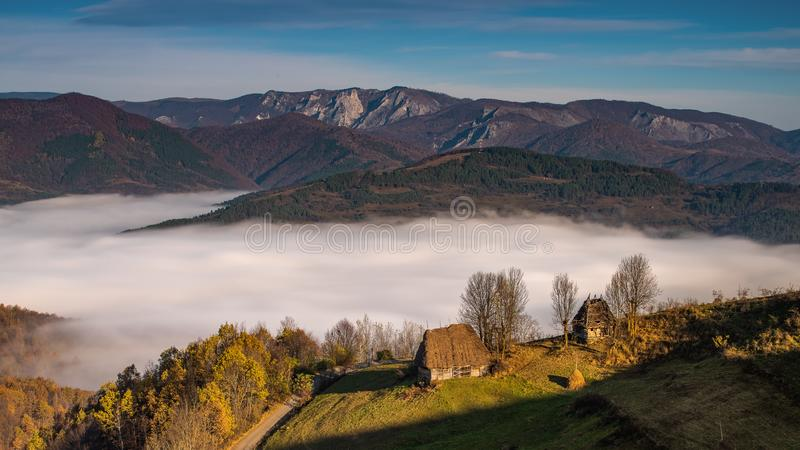 Transylvania landscape in autumn time with low clouds and frost in the morning Romania. Transylvania landscape in autumn time with low clouds and frost in the royalty free stock photography