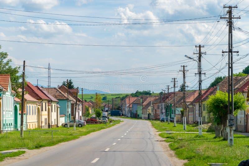 TRANSYLVANIA REGION, ROMANIA - 6 JUNE, 2017: A village road in a traditional Transylvanian region stock images