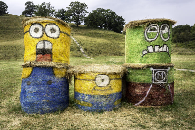 Transylvania, Romania - August 16, 2015: Minions drawn on hay bales. Action figure from Despicable Me 2 animated 3D film royalty free stock image