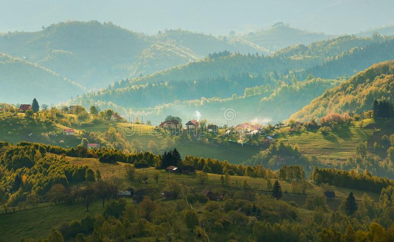 Transylvania rural landscape with a Romanian traditional village on the hills - Morning Mist stock images