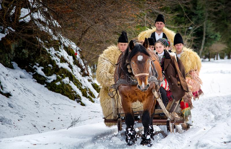 Transylvania winter time tradition with traditional sledge stock photo