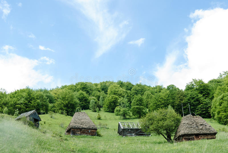 Transylvanian barns on a hill side stock image