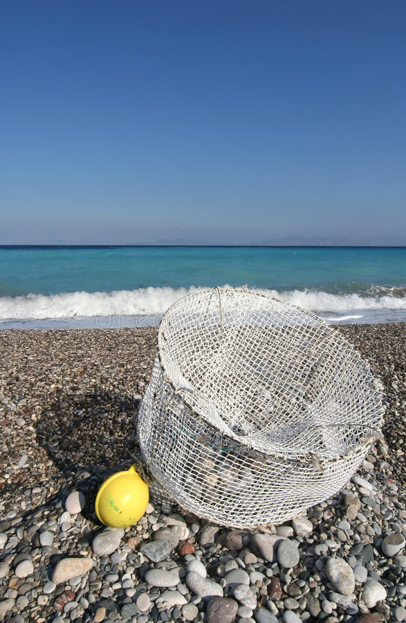 Trap on the Beach. Fish or lobster trap on Mediterrenean beach stock image