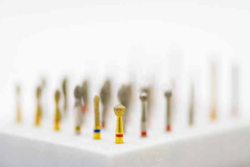 Trapani ed insieme di spazzole dentari fotografia stock