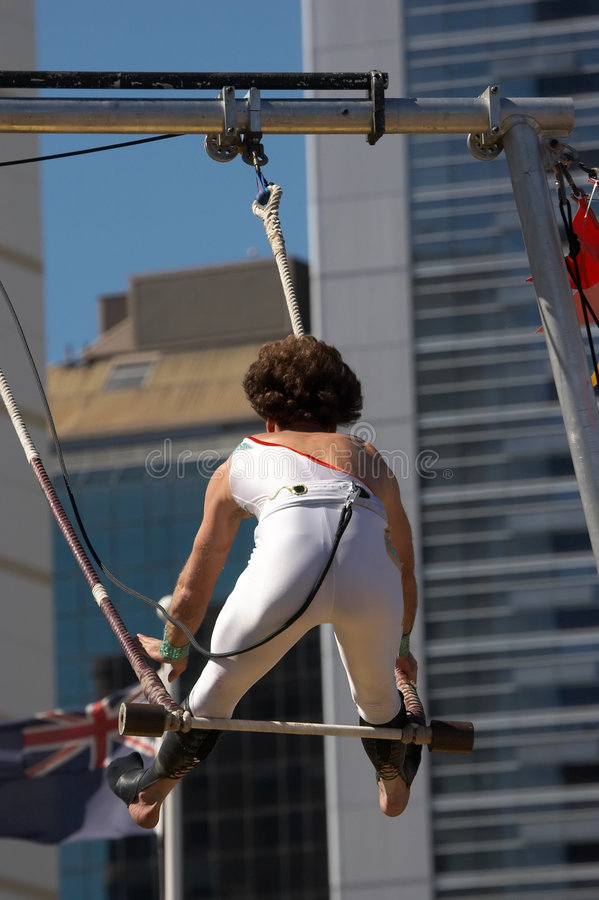 Trapeze. A trapeze artist swinging on the trapeze royalty free stock image
