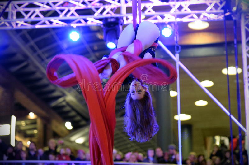 Trapeze Artist. A trapeze artist performs at Cabot Circus as the shopping mall officially opens for the Christmas holiday season on November 7, 2014 in Bristol stock image
