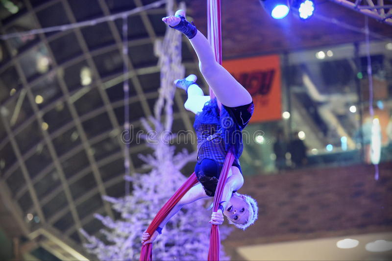 Trapeze Artist. A trapeze artist performs at Cabot Circus as the shopping mall officially opens for the Christmas holiday season on November 7, 2014 in Bristol royalty free stock photography