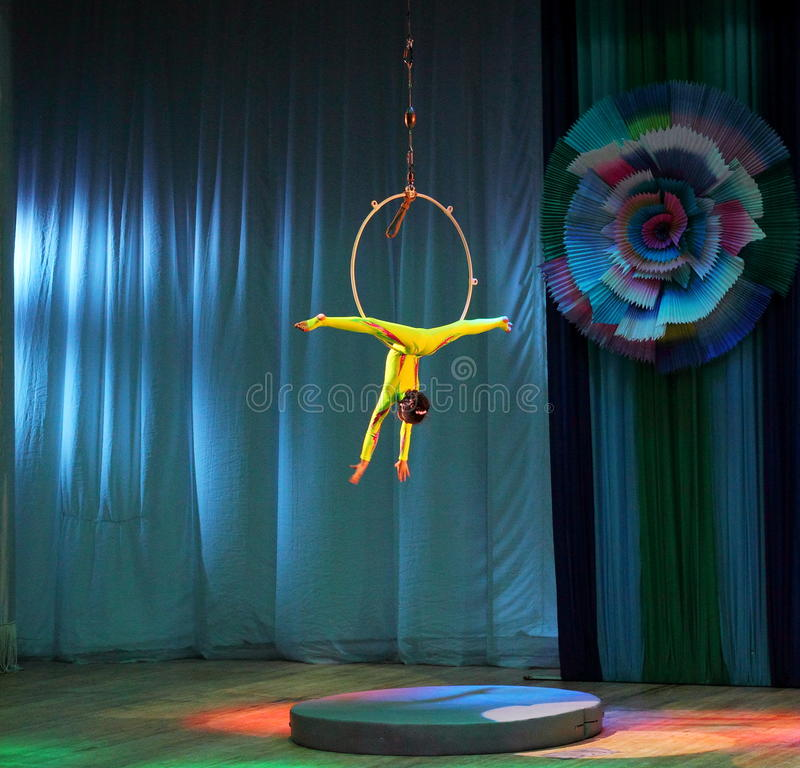 Trapeze artist in the ring. Young gymnast actress circus school Ale-up on the stage of the Kyiv Palace of children and youth. Festival First Steps. Kiev stock photo