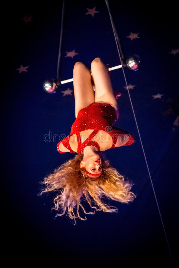 Trapeze Lady 4. OLD BRIDGE, NEW JERSEY -JUNE 8 - Kimberly Souren a trapeze artist hanging from the bar at the Kelly Miller Circus on June 8 2015 in Old Bridge royalty free stock photos