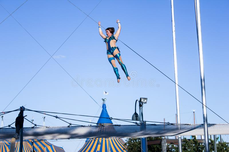 Trapeze show in the old port of Montreal royalty free stock photography