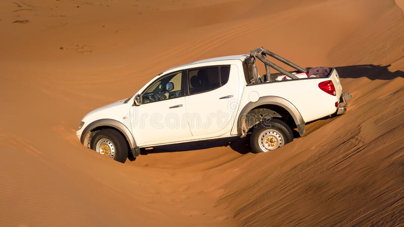 Trapped in the sand III. All Terrain Vehicle stuck in the sands of the Atacama Desert stock photo