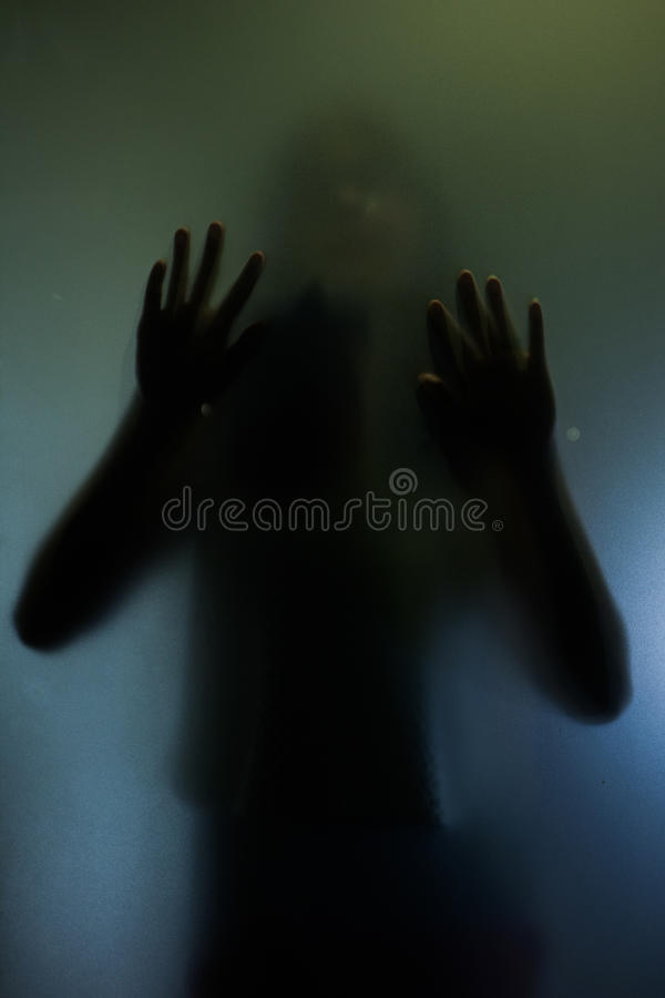 Trapped woman concept with back silhouette of hands stock photography