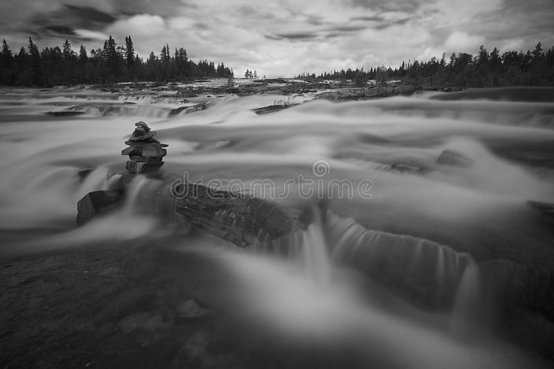 Trappstegsforsen, unique rapids in Sweden. Trappstegsforsen, the stairway rapids, unique rapids in Sweden. Black and white picture with long exposure. A small