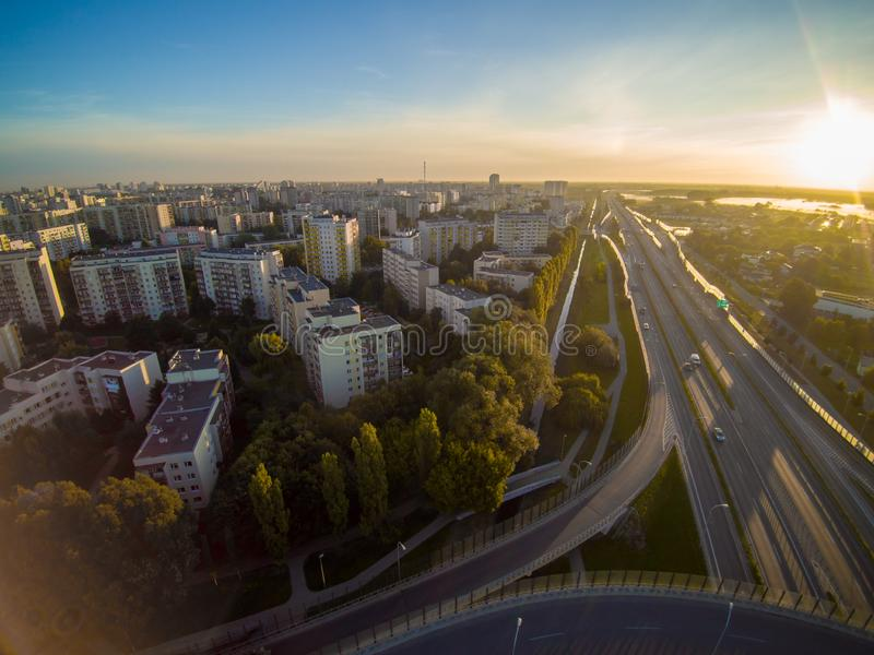 Trasa Siekierkowska road and Warsaw in Poland during sunrise. Trasa Siekierkowska in Praga Południe, Goclaw Las districts. Crossroad with Wal Miedzeszynski royalty free stock image
