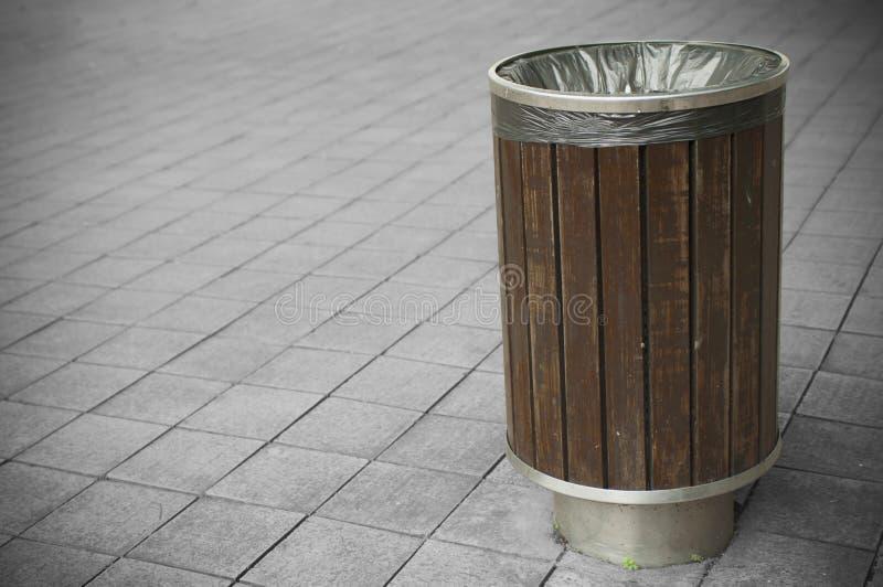 Trash Bin. Wooden trash bin in a park royalty free stock photos