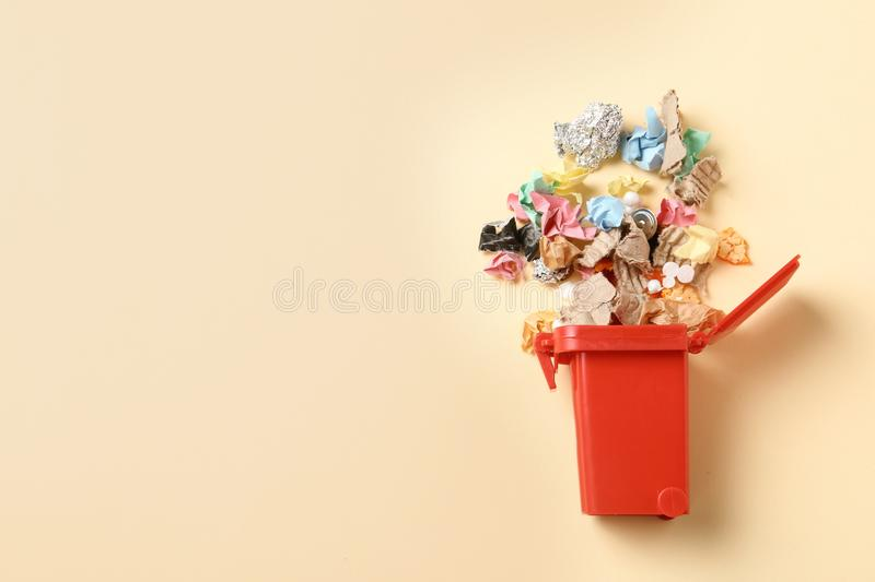 Trash bin and different garbage on color background, top view. Waste recycling concept. Trash bin and different garbage on color background, top view with space royalty free stock photos