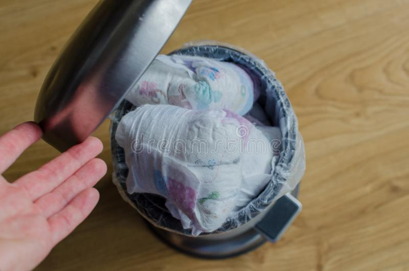Trash bin full of used diapers. Close up royalty free stock image