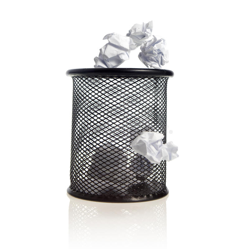 Trash bin with paper balls. On white background royalty free stock photos