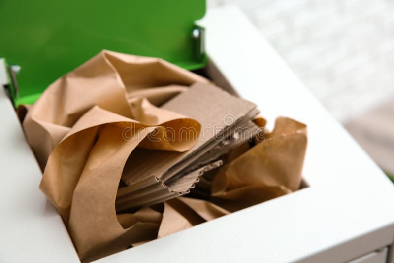 Trash bin with paper and cardboard. Recycling concept. Trash bin with paper and cardboard, closeup. Recycling concept royalty free stock photos