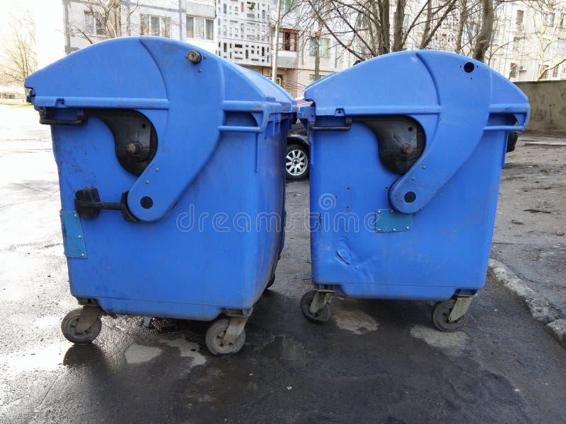 Trash bins. Two blue plastic trash bins stock photography