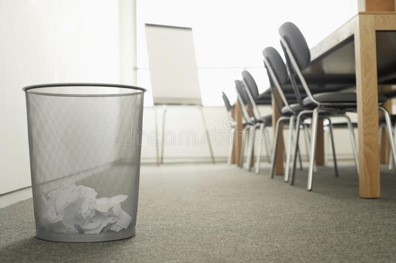Trash Can in Empty Meeting Room royalty free stock photo