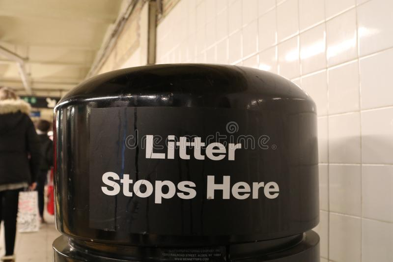 Trash can with sign for litter removal, New York City subeay royalty free stock photos