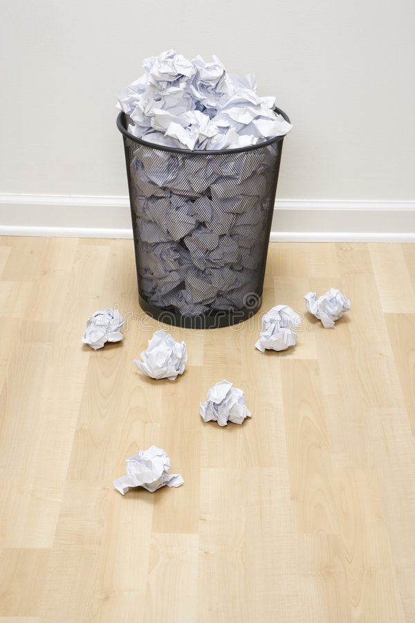 Trash can and paper. royalty free stock image