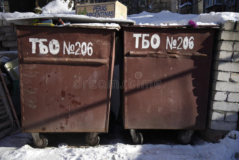 Trash can in winter royalty free stock photography