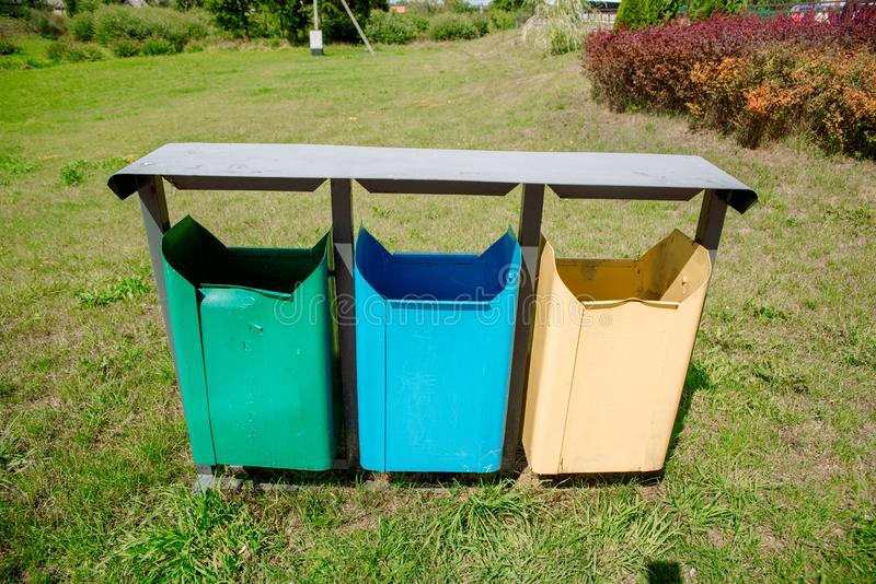 Trash Containers for Garbage Separation -- three colors for plastic, metal and burnables stock images