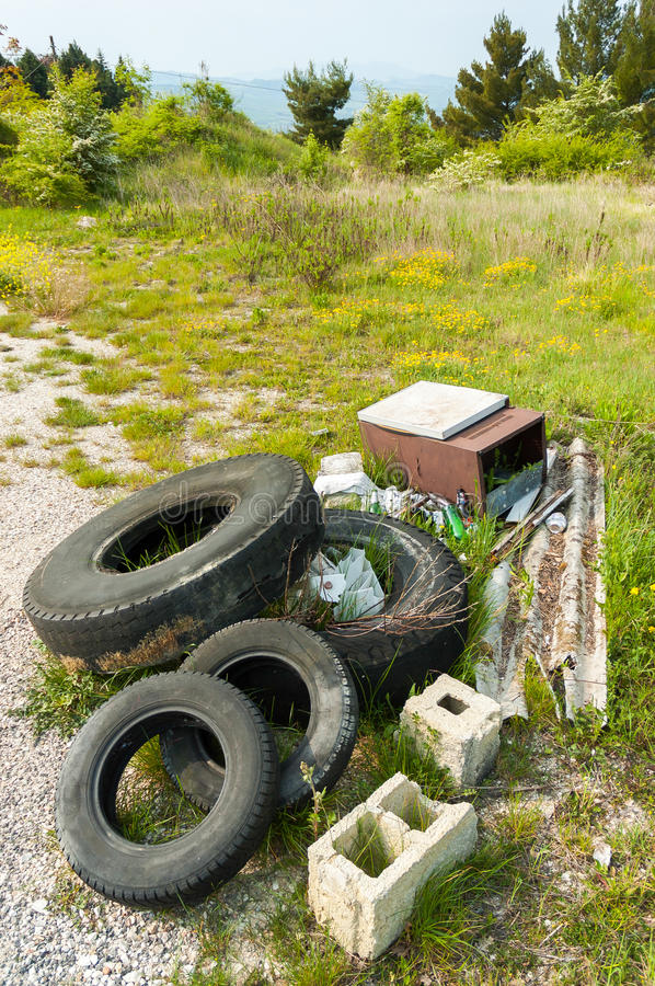 Trash in the country. Too much trash in Nature left by disrespectful people stock photo