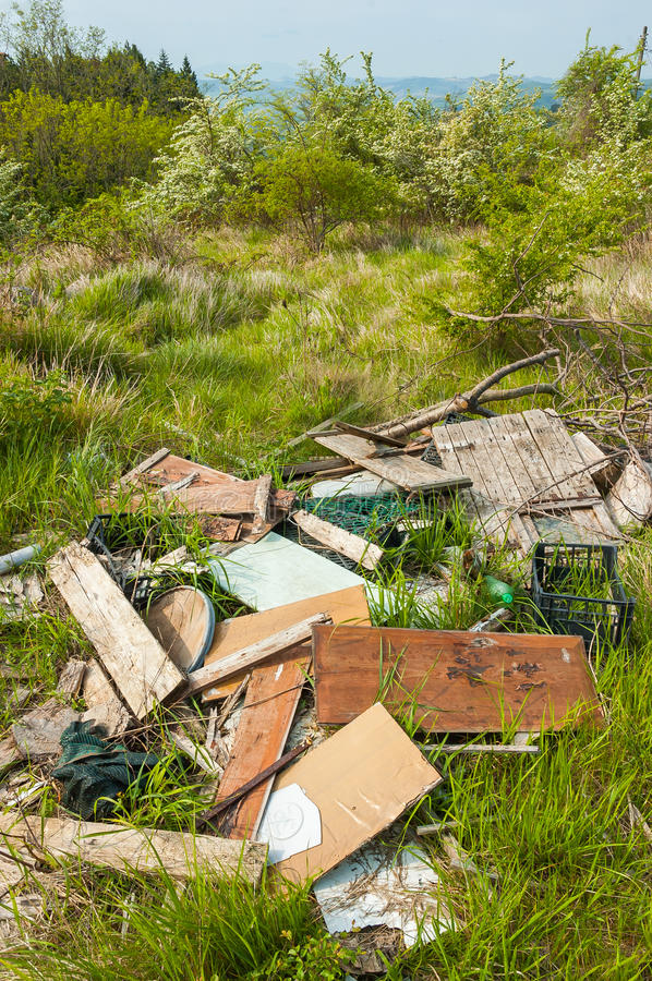Trash in the country. Too much trash in Nature left by disrespectful people royalty free stock image