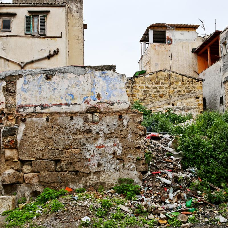 Trash and crumbling wall in a Palermo neighborhood stock images