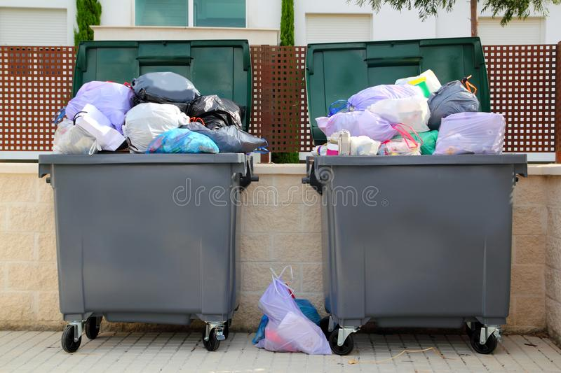 Trash garbage full container in street royalty free stock image