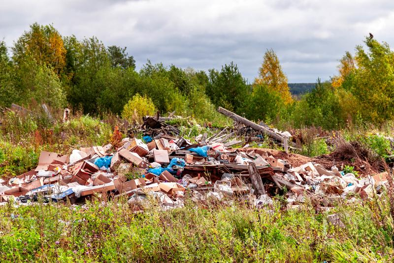 Trash landfill garbage pile in the agriculture field. Ecology pollution environment contamination problem concept stock image