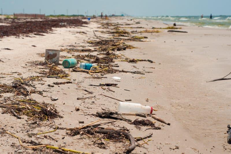 Trash on a Louisiana Beach from a Hurricane. Horizontal of a shoreline with trash and debris deposited by hurricane Irene on the Louisiana coast royalty free stock photo