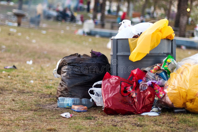 Trash in the park royalty free stock image