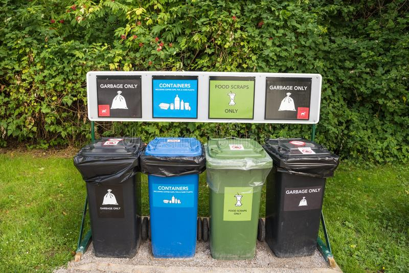 Trash and Recycling Cans in a Park stock photo