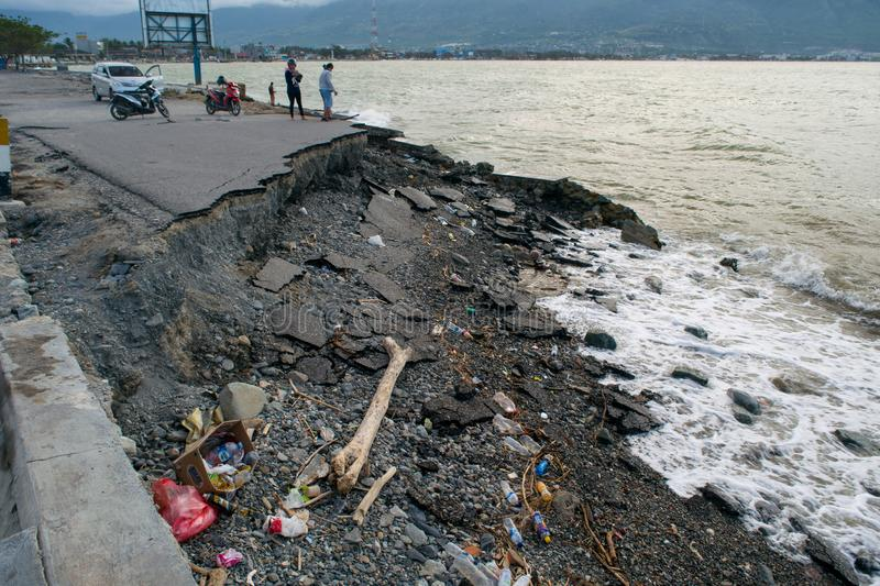 Trash throwed on coastline after tsunami in Palu, Indonesia. People throwing their trash on coastline after tsunami in Palu, Indonesia due by less garbage truck stock images
