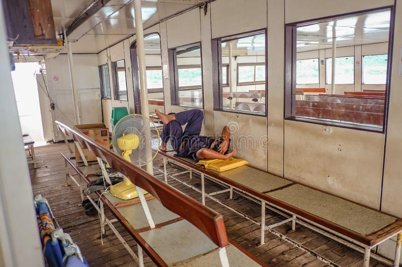 Unacquainted Thai Passenger Sleep on the Crossing Island Ferry from Koh chang island in Low Season travel in vacation time royalty free stock image