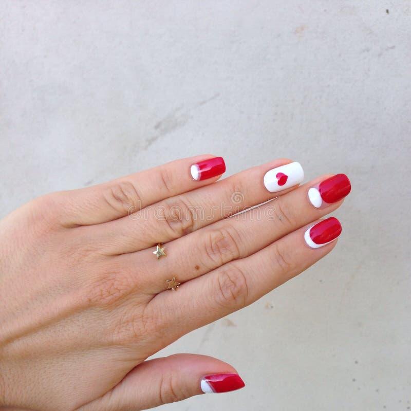 Tratamento de mãos branco vermelho foto de stock royalty free