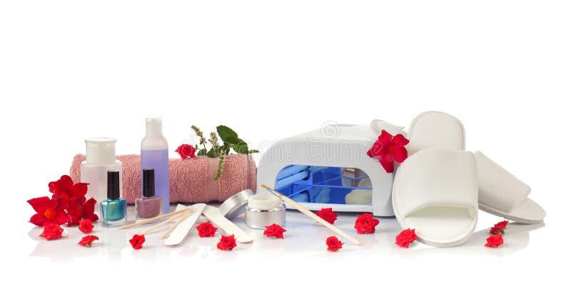 Tratamento de mãos e pedicure dos termas do prego com equipamento imagens de stock