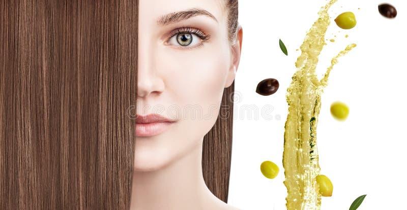 Tratamiento del pelo por terapia del aceite Chapoteo de la aceituna verde que vuela imagen de archivo libre de regalías