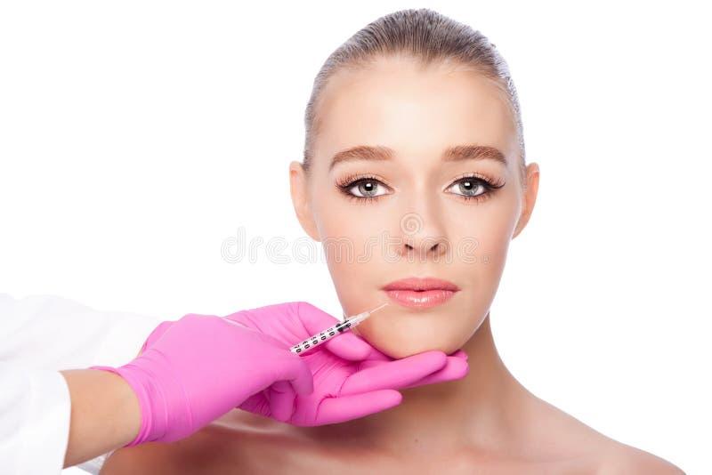 Tratamiento facial de la belleza del balneario de la inyección del labio foto de archivo