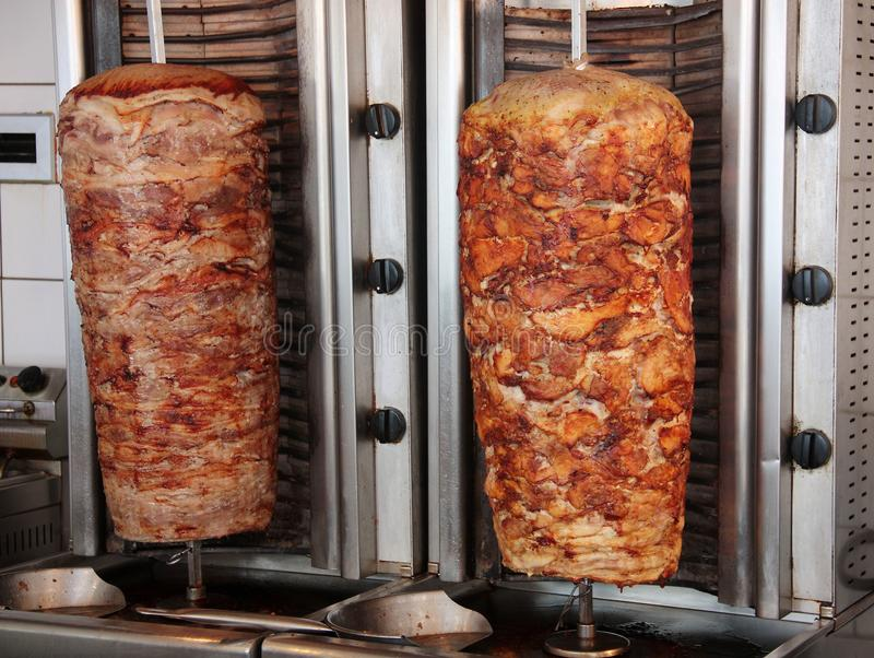 Tratidional greek gyros spits with pork chicken and lamb meat royalty free stock images