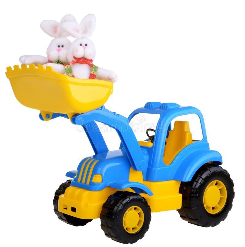 Trator do brinquedo com coelho de easter fotografia de stock royalty free