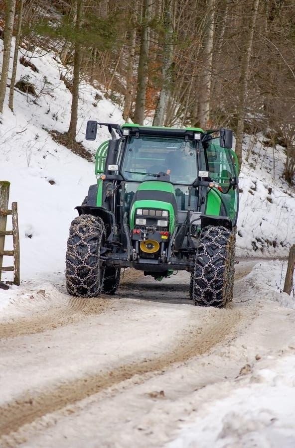Trator grande com correntes de neve fotografia de stock royalty free