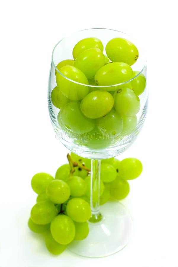 Trauben im Weinglas lizenzfreies stockfoto
