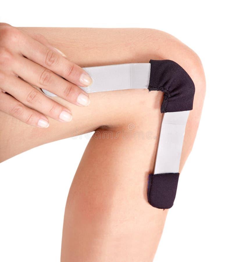 Trauma of knee in hinged brace. stock photos